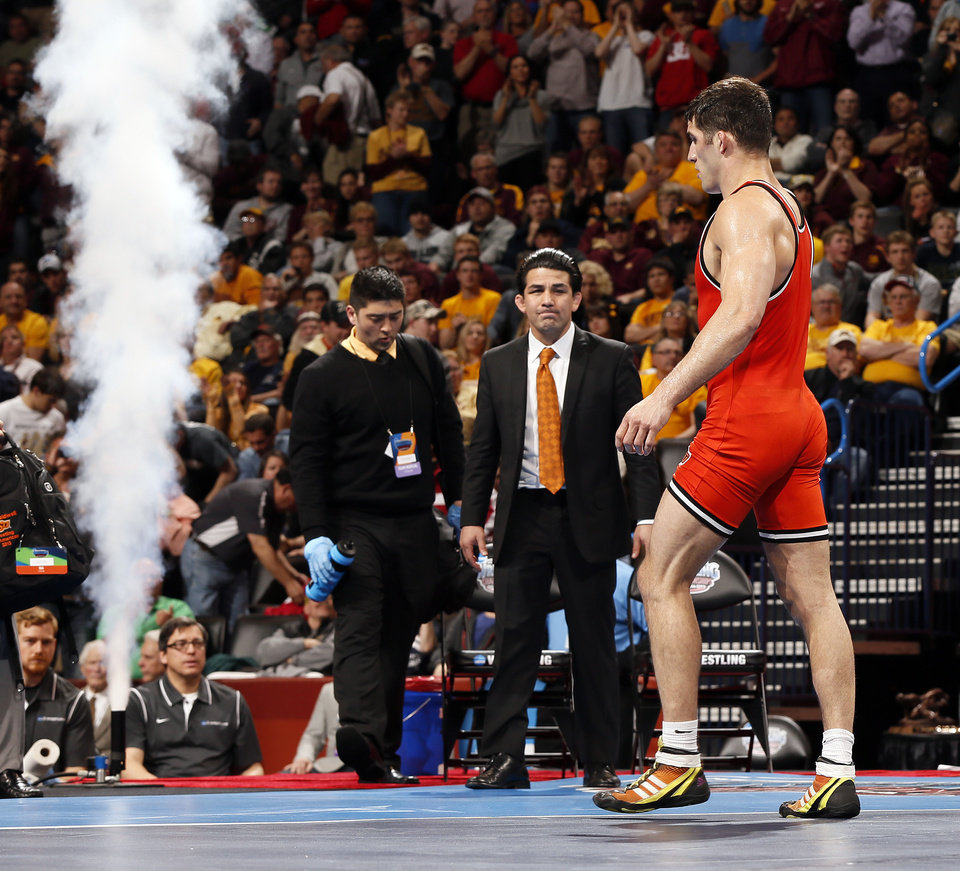 Photo - OSU's Tyler Caldwell leaves the mat after losing to Penn State's David Taylor at 165 pounds in the 2014 NCAA Div. I Wrestling Championships at Chesapeake Energy Arena in Oklahoma City, Saturday, March 22, 2014. Photo by Nate Billings, The Oklahoman