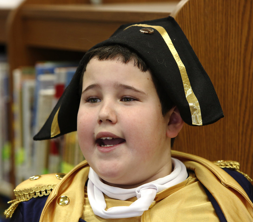 Photo - Jared Davis talks about the life of Nathan Hale, who was executed  by the British as a spy; he is considered America's first spy. He infiltrated British troops at the request of General George Washington.  Wearing authentic era attire, students in Rhonda Watkins' fourth and fifth grade social studies classes at Schwartz Elementary School portrayed various figures from the American Revolution period during  a living history museum program in the school's library on Wednesday,  Jan. 30,  2013.  The students selected a historical person from a list provided by Watkins, and  were required to research the subject, write a report and make a verbal presentation about the person. All students in the school were invited to the library to hear the characters tell about their lives.   Photo by Jim Beckel, The Oklahoman