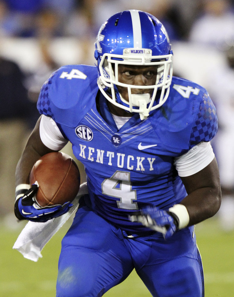 Photo -   Kentucky's Raymond Sanders runs downfield during the third quarter of an NCAA college football game against Kent State at Commonwealth Stadium in Lexington, Ky., Saturday, Sept. 8, 2012. (AP Photo/James Crisp)