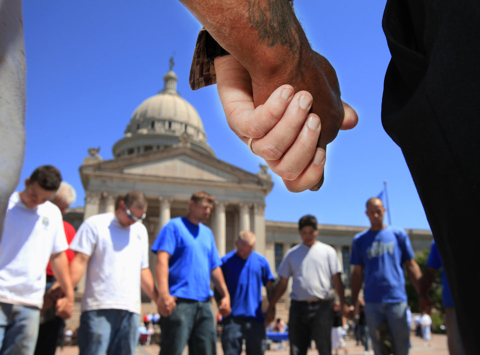Photo - A group of men from Gallian Masonry invited other men to join in a circle of prayer before the start of official ceremony.  After praying, one man described themselves as