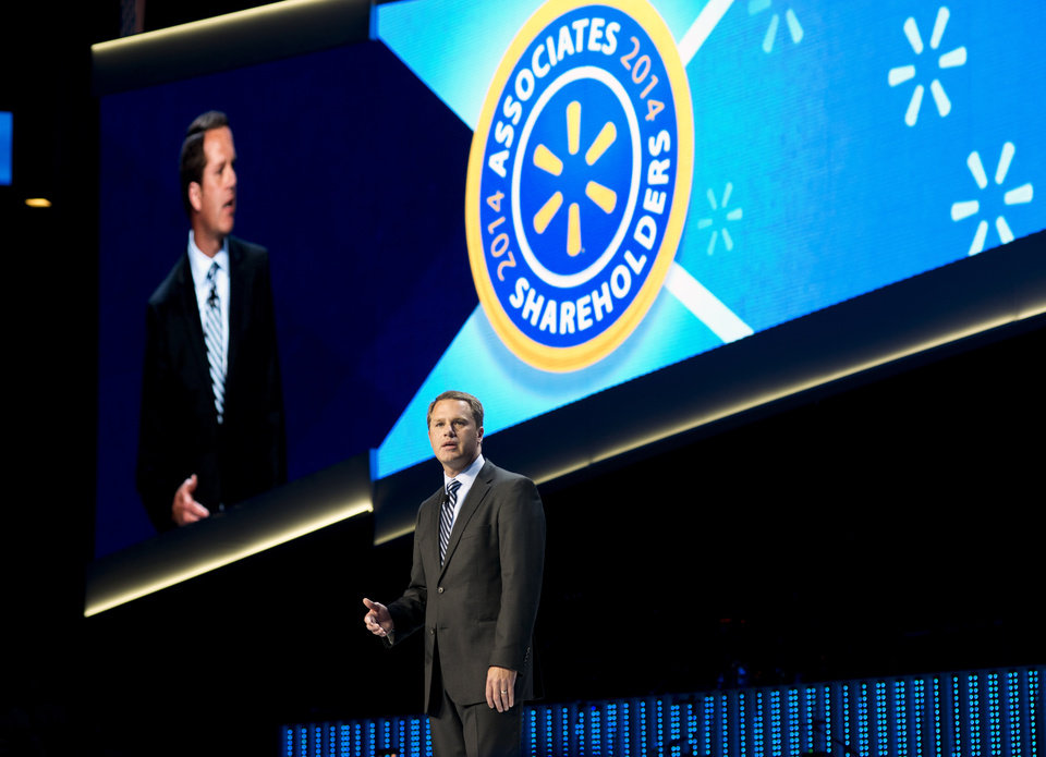 Photo - Doug McMillon, President and CEO of Wal-Mart Stores Inc., speaks during the annual Wal-Mart Shareholders meeting in Fayetteville, Ark., Friday June 6, 2014. The annual Wal-Mart shareholder's meeting drew about 14,000 people, including its workers from around the globe. (AP Photo/Sarah Bentham)