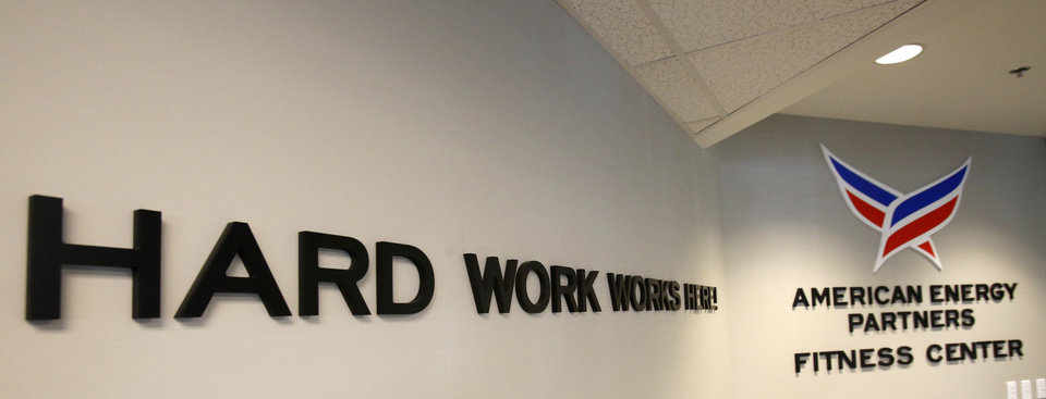 "Photo - The on-site fitness facility of American Energy Partners bears the company slogan — ""Hard work works here"" — which is used on everything from the company's Corporate Challenge T-shirts to employment advertisements.  Photo by David McDaniel, The Oklahoman  David McDaniel -  The Oklahoman"