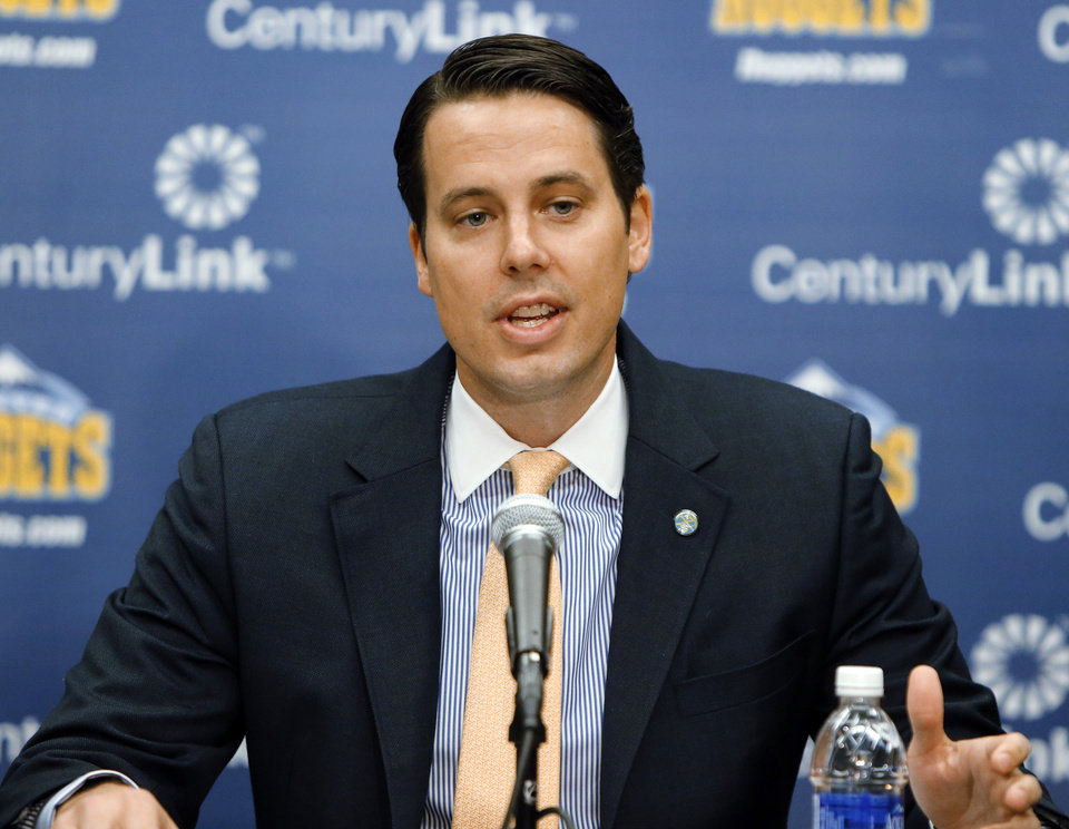Photo - Josh Kroenke, president of the NBA Denver Nuggets, talks about the firing of coach George Karl and the future of the Nuggets at a news conference at the Pepsi Center in Denver on Friday, June 7, 2013. Karl, who was named the NBA's Coach of the Year recently,  is following general manager Masai Ujiri out the door in Denver after Ujiri, the league's executive of the year, recently left to become GM of the Toronto Raptors. (AP Photo/Ed Andrieski)