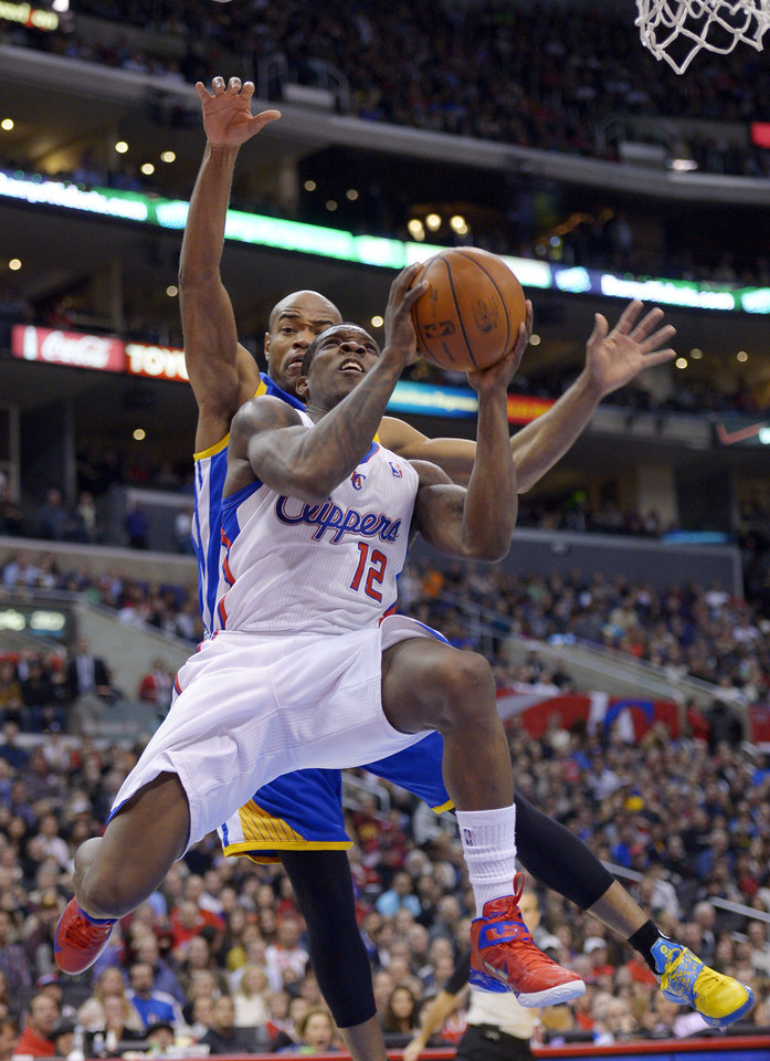 Los Angeles Clippers guard Eric Bledsoe (12) goes up for a shot as Golden State Warriors guard Jarrett Jack defends during the first half of an NBA basketball game, Saturday, Jan. 5, 2013, in Los Angeles.  (AP Photo/Mark J. Terrill)