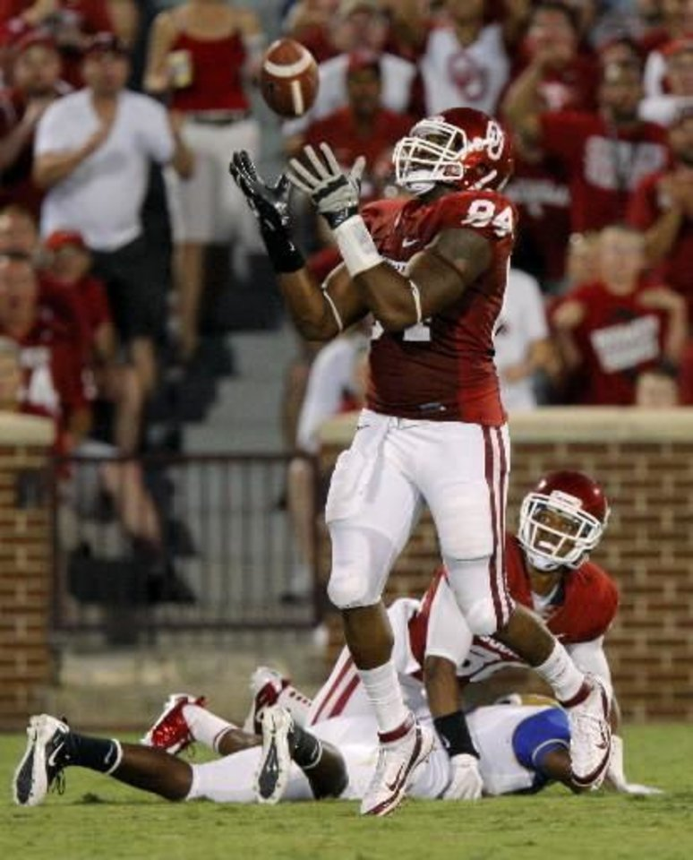 Oklahoma's Frank Alexander (84) intercepts a pass as Oklahoma's Jamell Fleming (32) watches during the college football game between the University of Oklahoma Sooners ( OU) and the Tulsa University Hurricanes (TU) at the Gaylord Family-Memorial Stadium on Saturday, Sept. 3, 2011, in Norman, Okla. Photo by Bryan Terry, The Oklahoman ORG XMIT: KOD