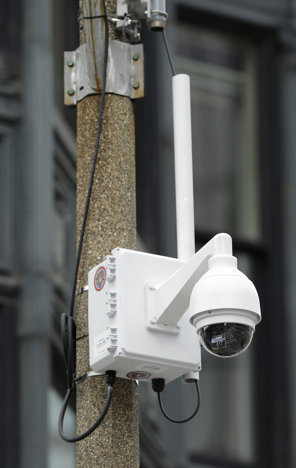 Photo - A surveillance camera is attached to a light pole along Boylston Street near the finish line of the Boston Marathon, Monday, April 14, 2014, in Boston. A year after twin pressure cooker bombs shattered the marathon and paralyzed the area for days, federal prosecutors say they have a trove of evidence ready to use against the surviving suspect, but many questions remain. (AP Photo/Steven Senne)