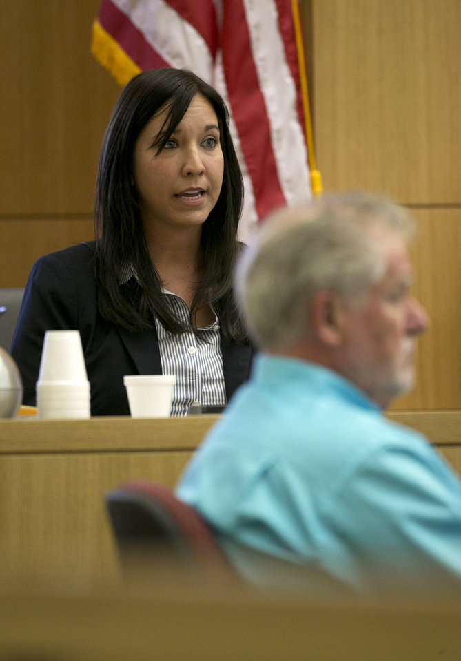 Photo - Dr. Janeen DeMarte an expert witness for the prosecution responds to questions from Prosecutor Juan Martinez during the Jodi Arias trial at Maricopa County Superior Court in Phoenix on Tuesday, April 16, 2013. Defense attorneys rested their case Tuesday after about 2 1/2 months of testimony aimed at portraying Arias as a domestic violence victim who fought for her life the day she killed her one-time boyfriend. (AP Photo/The Arizona Republic, David Wallace, Pool)