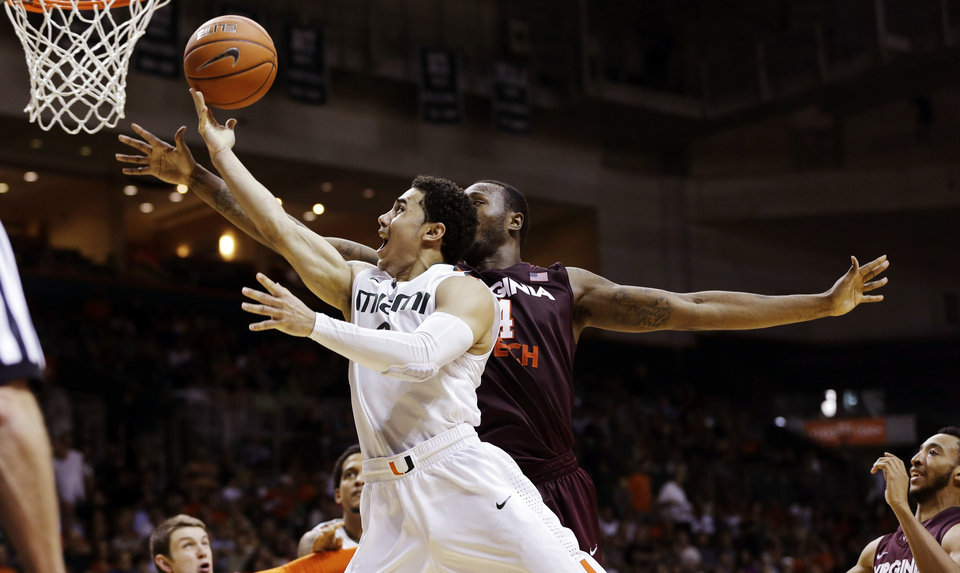 Miami\'s Shane Larkin (0) shoots past Virginia Tech\'s Cadarian Raines (4) during the second half of an NCAA college basketball game in Coral Gables, Fla., Wednesday, Feb. 27, 2013. Miami won 76-58. (AP Photo/J Pat Carter) ORG XMIT: FLJC109