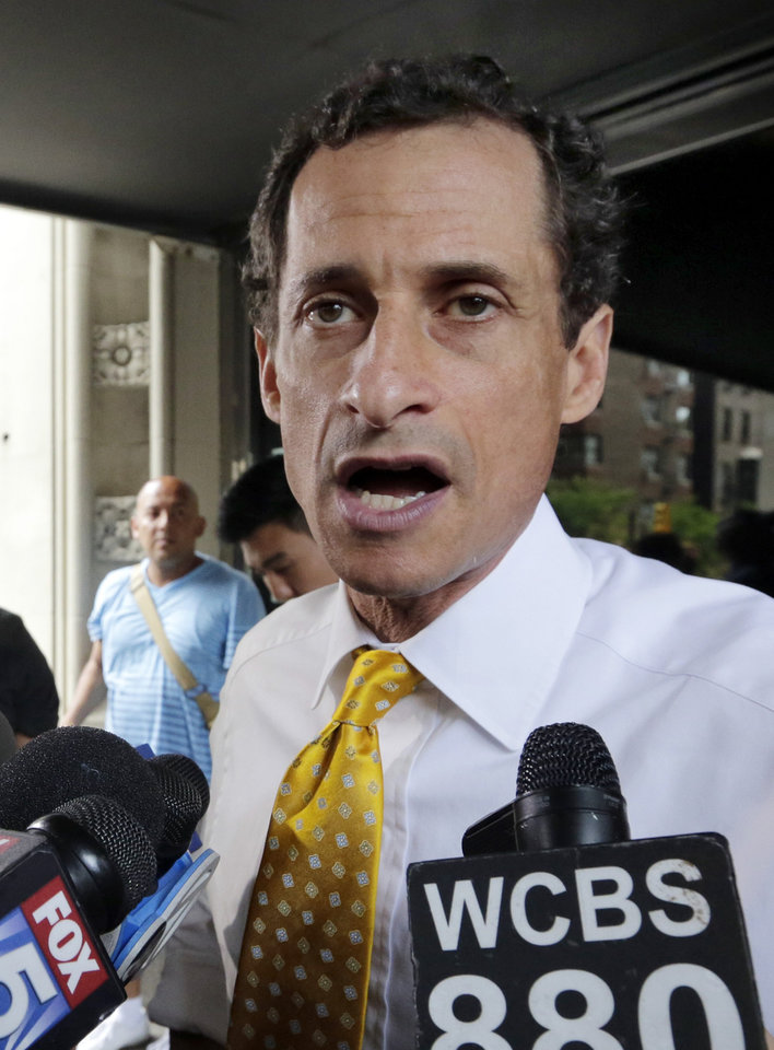 Photo - New York City mayoral candidate Anthony Weiner speaks to reporters as he leaves his apartment building in New York on Wednesday, July 24, 2013. The former congressman acknowledged sending explicit text messages to a woman as recently as last summer, more than a year after sexting revelations destroyed his congressional career. (AP Photo/Richard Drew)