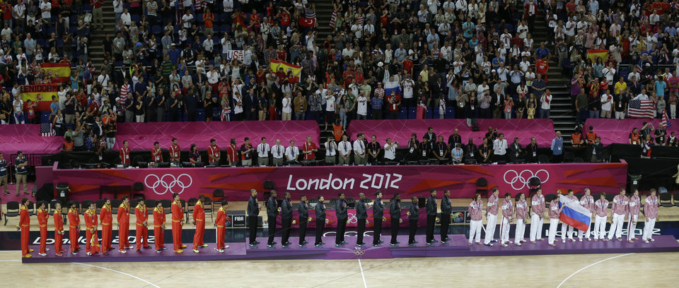 Team United States, middle, displays the gold medal, team Spain, at left, displays the silver medal and team Russia displays the bronze medal for men's basketball during a ceremony at the 2012 Summer Olympics, Sunday, Aug. 12, 2012, in London.(AP Photo/Victor Caivano)