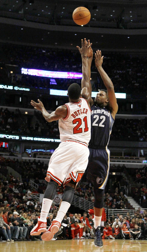 Photo -   Memphis Grizzlies forward Rudy Gay (22) shoots over Chicago Bulls guard Jimmy Butler (21) during the first half of a preseason NBA basketball game, Tuesday, Oct. 9, 2012, in Chicago. (AP Photo/Charles Rex Arbogast)