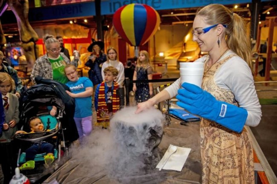 Photo -  A museum educator does a demonstration with liquid nitrogen during a previous wizard-themed Late Nite Lab at Science Museum Oklahoma. [PROVIDED]