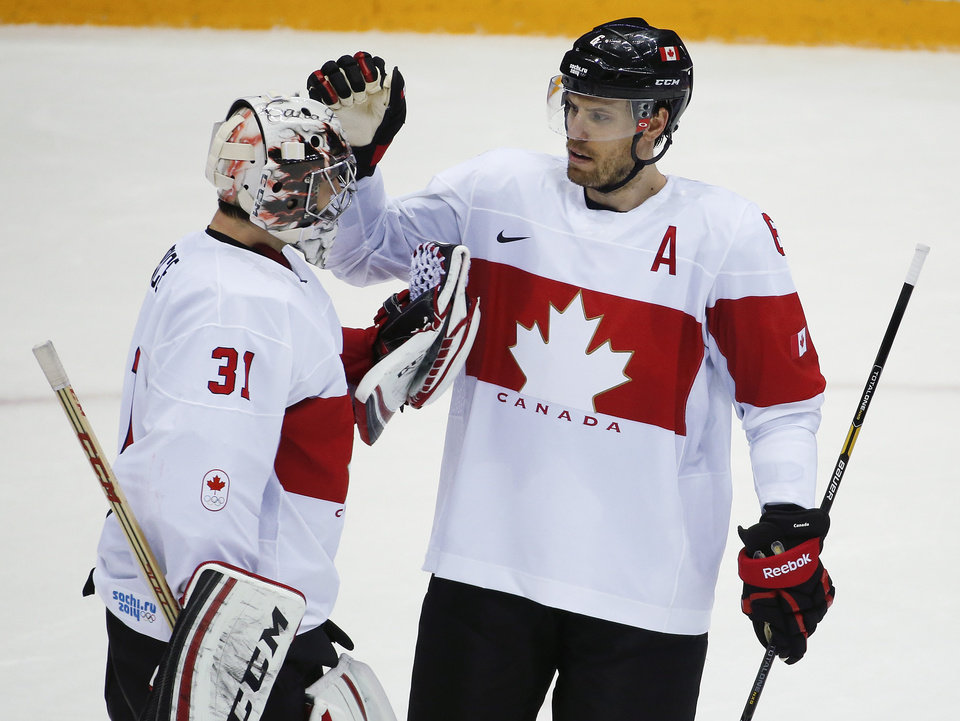 Photo - Canada defenseman Shea Weber congratulates Canada goaltender Carey Price after Canada defeated Latvia 2-1in a men's quarterfinal ice hockey game at the 2014 Winter Olympics, Wednesday, Feb. 19, 2014, in Sochi, Russia. (AP Photo/Mark Humphrey)