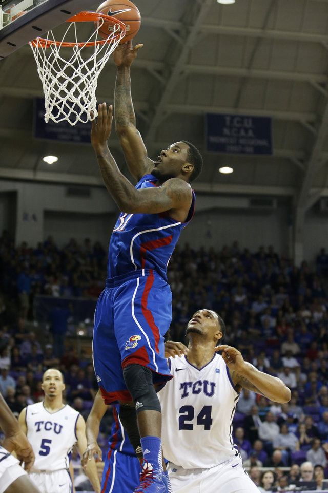 Kansas forward Jamari Traylor (31) scores as TCU forward Adrick McKinney, right, watches during the first half of an NCAA college basketball game Wednesday, Feb. 6, 2013, in Fort Worth, Texas. (AP Photo/Sharon Ellman)