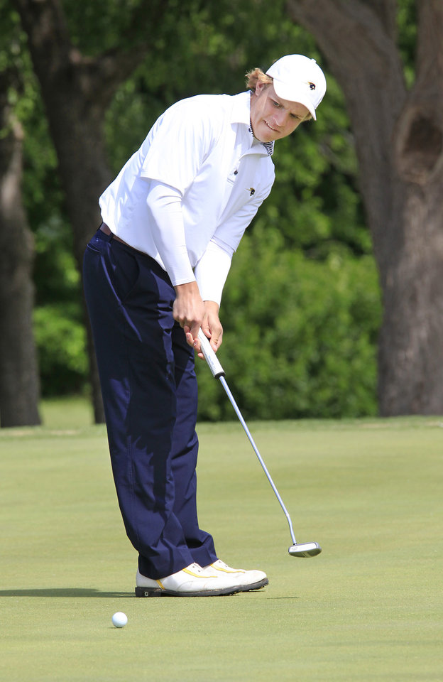 Photo - Andrew McDonald, Heritage Hall, putts during the Class 4A boys golf at Lake Hefner Golf Course, Tuesday May 13, 2014.  Photo by David McDaniel, The Oklahoman