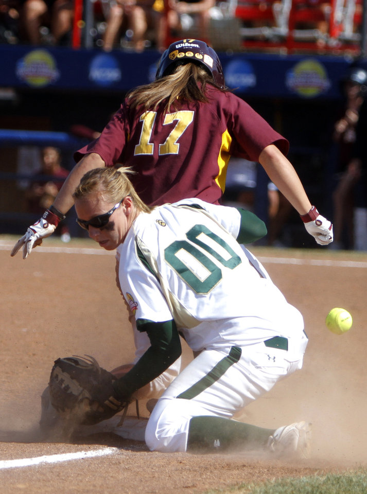 Photo - Baylor's Megan Turk (00) drops a ball as Arizona State's Katelyn Boyd (17) stands on third during the Women's College World Series game between Arizona State and Baylor at the ASA Hall of Fame Stadium in Oklahoma City, Sunday, June 5, 2011. Photo by Sarah Phipps, The Oklahoman