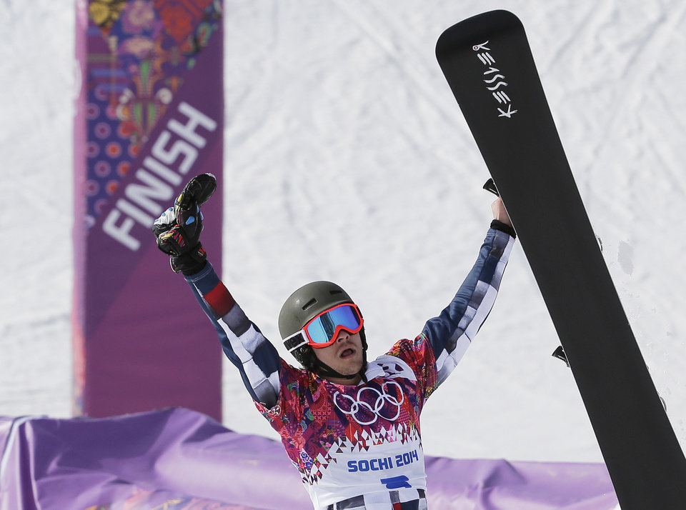 Photo - Russia's Vic Wild celebrates his gold medal in the men's snowboard parallel slalom final at the Rosa Khutor Extreme Park, at the 2014 Winter Olympics, Saturday, Feb. 22, 2014, in Krasnaya Polyana, Russia. (AP Photo/Andy Wong)