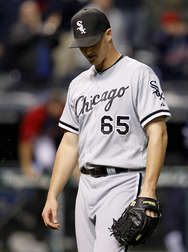 Photo -   Chicago White Sox's Nate Jones walks back to the dugout after Cleveland Indians' Jason Donald hit an RBI single off Jones in the 12th inning of a baseball game, Tuesday, Oct. 2, 2012, in Cleveland. The Indians won 4-3. (AP Photo/Tony Dejak)