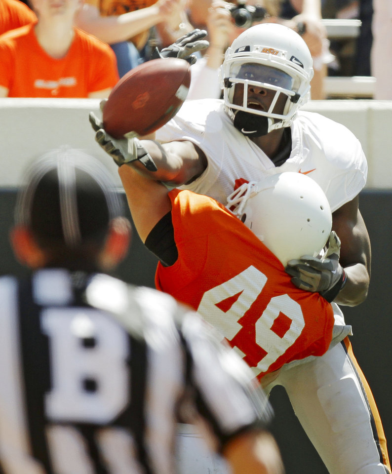 OSU's Justin Blackmon (81) misses a touchdown catch as Colby Ellis (49) defends during the Orange/White spring football game for the Oklahoma State University Cowboys at Boone Pickens Stadium in Stillwater, Okla., Saturday, April 16, 2011. Photo by Nate Billings, The Oklahoman