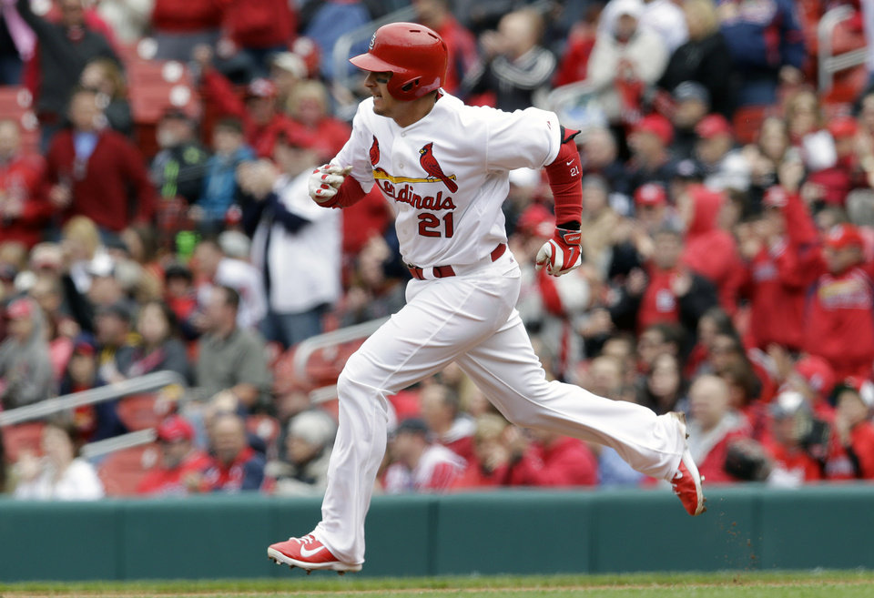 Photo - St. Louis Cardinals' Allen Craig heads to second on a two-run double during the fourth inning of a baseball game against the Milwaukee Brewers, Wednesday, April 30, 2014, in St. Louis. (AP Photo/Jeff Roberson)