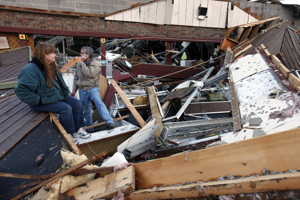 Sherry Cousins and her brother Bruce Wallace of Hollister, Mo., sit in the wreckage of their secondhand store in Branson, Mo, Wednesday, Feb. 29, 2012. A powerful storm system that produced multiple reports of tornadoes lashed the Midwest early Wednesday, roughing up the country music resort city of Branson.  (AP Photo/Mark Schiefelbein) ORG XMIT: MOMS101