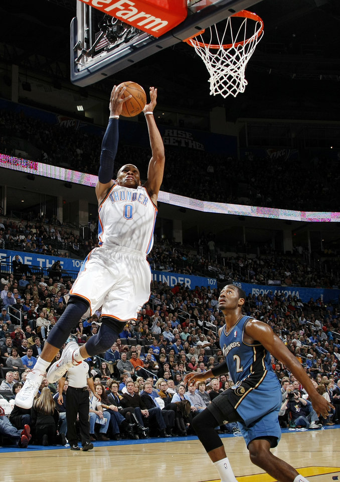 Oklahoma City\'s Russell Westbrook (0) moves to the hoop past John Wall (2) of Washington during the NBA basketball game between the Washington Wizards and the Oklahoma City Thunder at the Oklahoma City Arena in Oklahoma City, Friday, January 28, 2011. Photo by Nate Billings, The Oklahoman