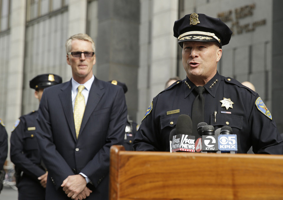 Photo - San Francisco Police Chief Greg Suhr, right, talks about the arrest of Ryan Kelly Chamberlain II, during a news conference outside the federal building as FBI Special Agent in Charge David Johnson, left, looks on Tuesday, June 3, 2014, in San Francisco. The San Francisco social media maven and former political consultant wanted on suspicion of possessing explosives is in FBI custody after a three-day manhunt. The San Francisco police caught Chamberlain, 42, on Monday afternoon in his car near Crissy Field, just south of the Golden Gate Bridge. (AP Photo/Eric Risberg)