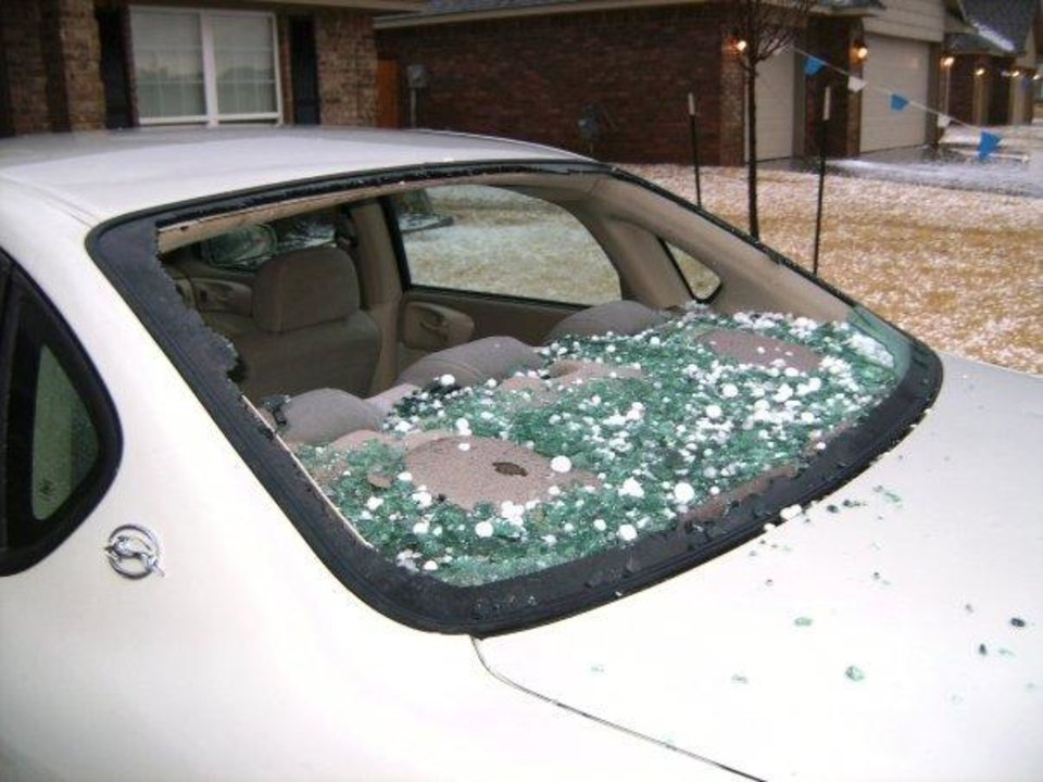 Photo - Hail in Surrey Hills knocked out the back window of this car.