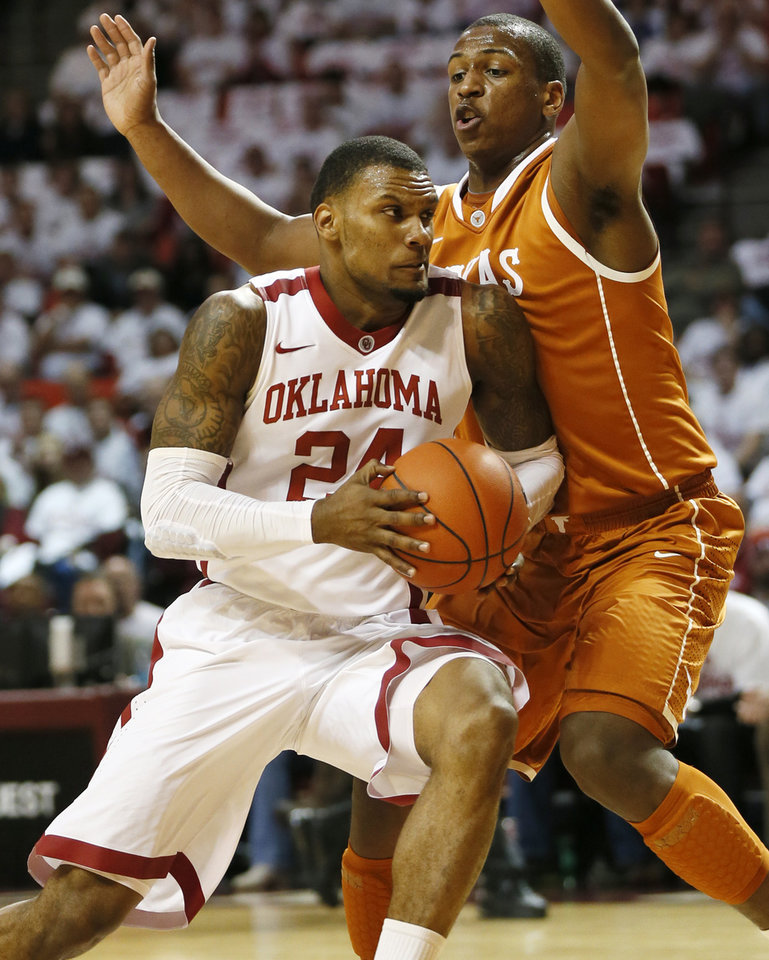 Oklahoma's Romero Osby (24) drives to the basket against Texas' Jonathan Holmes (10) during a men's college basketball game between the University of Oklahoma (OU) and the University of Texas at the Lloyd Noble Center in Norman, Okla., Monday, Jan. 21, 2013. Photo by Nate Billings, The Oklahoman