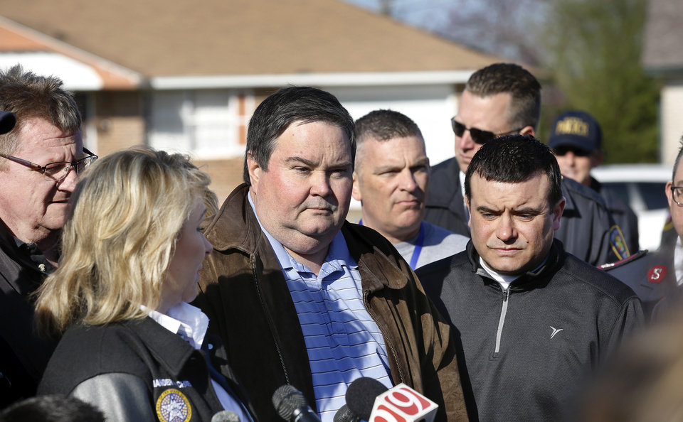 Photo - Gov. Mary Fallin  with state officials at the site of Southgate-Rippetoe Elementary School on Thursday morning, March 26, 2015, the day after a tornado damaged homes and the  school. At far left is Albert Ashwood, director of the state's emergency management. Also with the governor are Moore Mayor Glenn Lewis, Robert Romines, superintendent, Moore Public Schools, and state Sen. Anthony Sykes. Photo by Jim Beckel, The Oklahoman