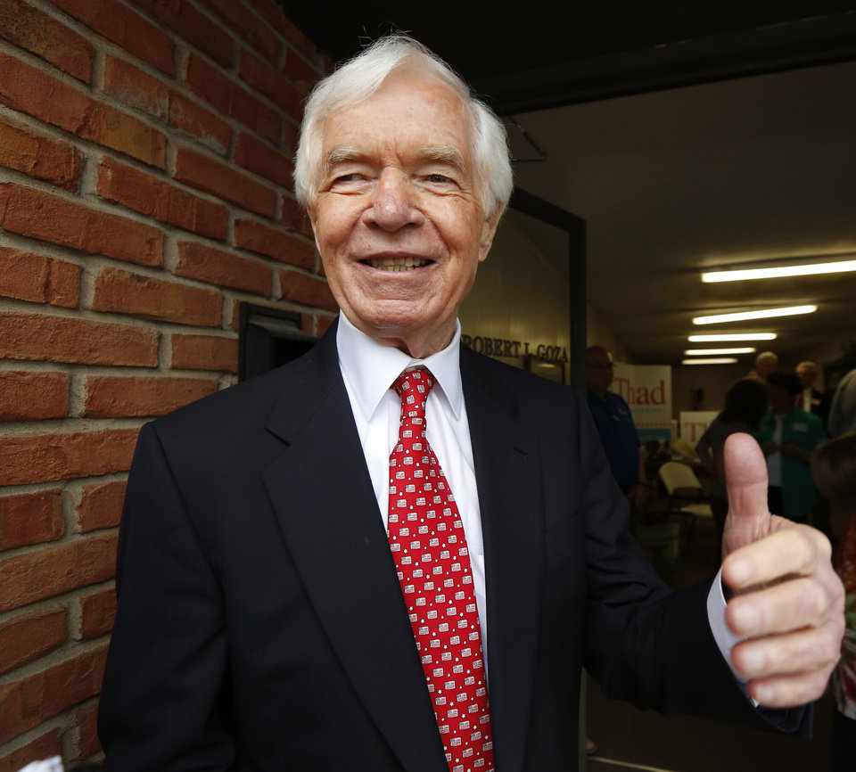 Photo - U.S. Sen. Thad Cochran, R-Miss., greets supporters and volunteers  at his Canton, Miss., headquarters, Tuesday, June 24, 2014. Cochran is in the Republican primary runoff election against state Sen. Chris McDaniel on Tuesday. (AP Photo/Rogelio V. Solis)