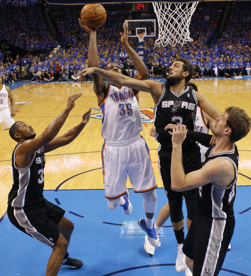 Photo - Oklahoma City's Kevin Durant (35) goes to the basket between San Antonio's Boris Diaw (33), Marco Belinelli (3), and Tiago Splitter (22) during Game 3 of the Western Conference Finals in the NBA playoffs between the Oklahoma City Thunder and the San Antonio Spurs at Chesapeake Energy Arena in Oklahoma City, Sunday, May 25, 2014. Photo by Bryan Terry, The Oklahoman