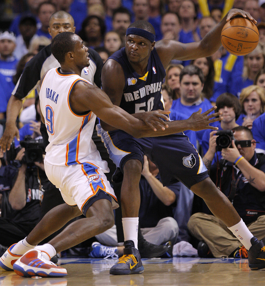 Oklahoma City\'s Serge Ibaka (9) defends on Zach Randolph (50) of Memphis during game two of the Western Conference semifinals between the Memphis Grizzlies and the Oklahoma City Thunder in the NBA basketball playoffs at Oklahoma City Arena in Oklahoma City, Tuesday, May 3, 2011. Photo by Bryan Terry, The Oklahoman