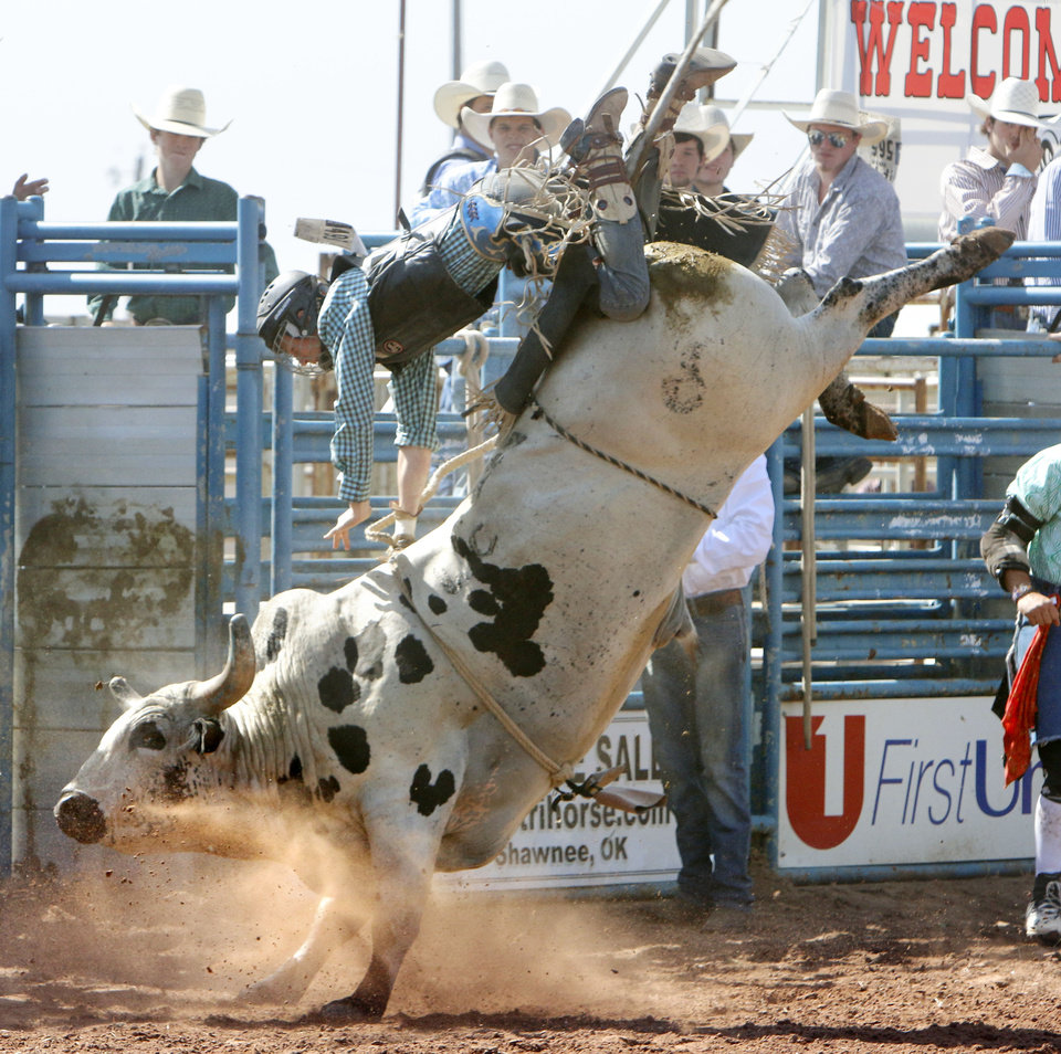 Photo - Robert Gracie, from Grand Junction, CO, gets thrown from his bull in the Bull Riding event during Tuesday's performances at the International Youth Finals Rodeo at the Shawnee Heart of Oklahoma Exposition Center in Shawnee, OK, Tuesday, July 8, 2014,  Photo by Paul Hellstern, The Oklahoman