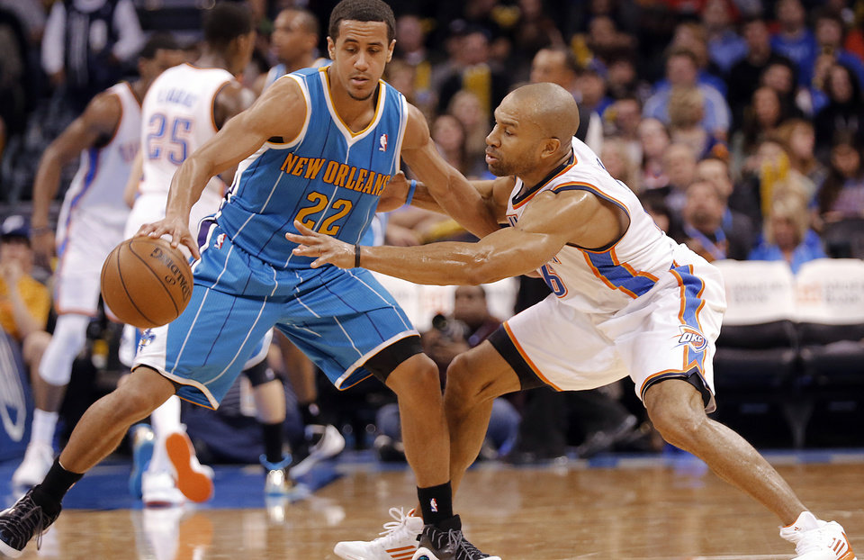 Photo - Oklahoma City Thunder's Derek Fisher (6) defends on New Orleans Hornets' Brian Roberts (22) during the NBA basketball game between the Oklahoma City Thunder and the New Orleans Hornets at the Chesapeake Energy Arena on Wednesday, Feb. 27, 2013, in Oklahoma City, Okla. Photo by Chris Landsberger, The Oklahoman