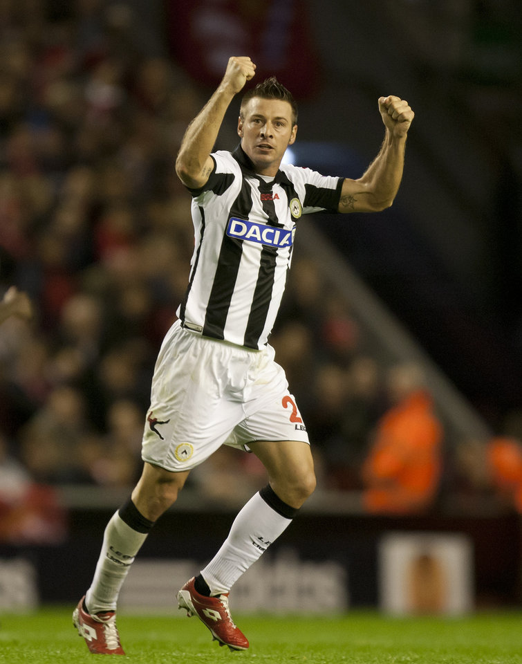 Photo -   Udinese's Giovanni Pasquale celebrates after scoring against Liverpool during their Europa League Group A soccer match at Anfield Stadium, Liverpool, England, Thursday Oct. 4, 2012. (AP Photo/Jon Super)