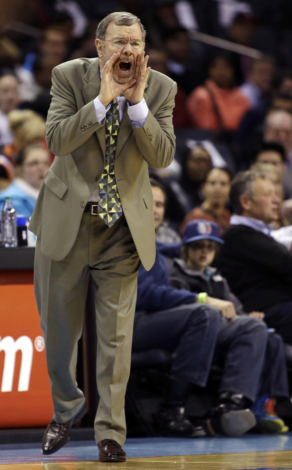 Photo - Brooklyn Nets interim head coach P.J. Carlesimo yells out a play during the first half of an NBA basketball game against the Charlotte Bobcats in Charlotte, N.C., Wednesday, March 6, 2013. (AP Photo/Bob Leverone)