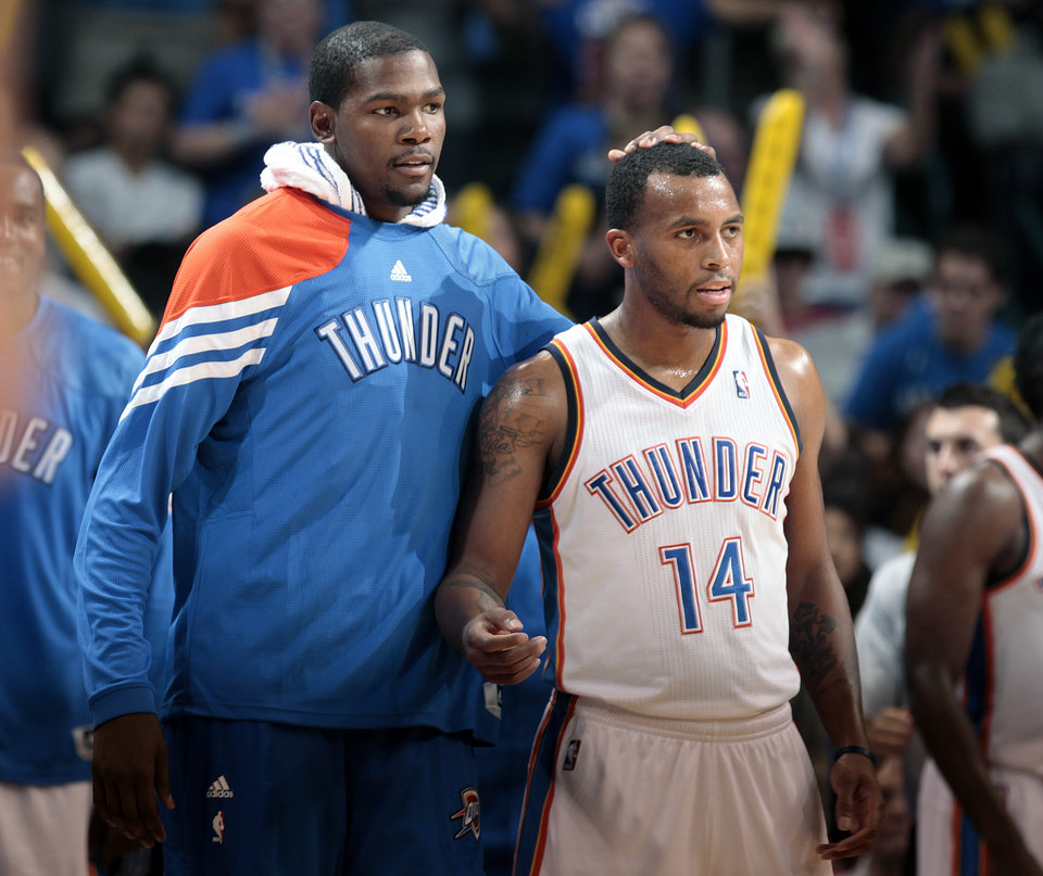 Oklahoma City\'s Kevin Durant (35) celebrates with Oklahoma City\'s Daequan Cook (14) during the NBA preseason basketball game between the Oklahoma City Thunder and the Denver Nuggets at the Chesapeake Energy Arena, Sunday, Oct. 21, 2012. Photo by Sarah Phipps, The Oklahoman