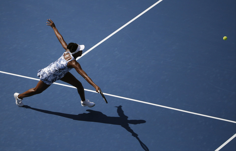 Photo - Venus Williams, of the United States, lunges for a shot against Kimiko Date-Krumm, of Japan, during the opening round of the 2014 U.S. Open tennis tournament, Monday, Aug. 25, 2014, in New York. (AP Photo/Elise Amendola)