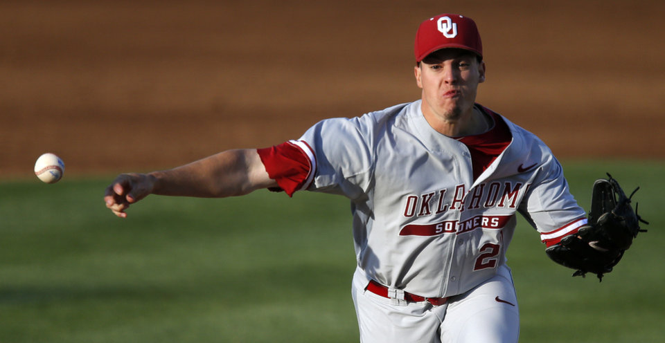 Photo - OU's Robert Tasin pitches during a Bedlam baseball game between Oklahoma State University and the University of Oklahoma in Stillwater, Tuesday, April 15, 2014. Photo by Bryan Terry, The Oklahoman