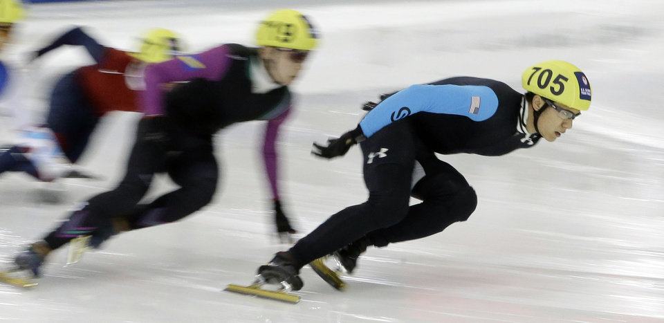 Photo - J. R. Celski, right, leads the pack as he competes in the men's 1,000 meters during the U.S. Olympic short track speedskating trials Sunday, Jan. 5, 2014, in Kearns, Utah. (AP Photo/Rick Bowmer)