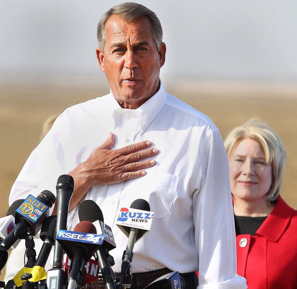 Photo - House Speaker John Boehner talks about the drought in the Central Valley, Wednesday, Jan. 22, 2014, during a news conference on farmer Larry Starrh's land, northwest of Bakersfield, Calif. State Sen. Jean Fuller is behind him. Boehner visited a dusty California field, joining Central Valley Republicans to announce an emergency drought-relief bill to help farmers through what is certain to be a devastating year. If passed, the bill that's already stirring controversy would temporarily halt restoration of the San Joaquin River designed to bring back the historic salmon flow, among other measures. Farmers want that water diverted to their crops. (AP photo/The Bakersfield Californian, Casey Christie) MAGS OUT  ONLINES OUT  TV OUT  NO SALES