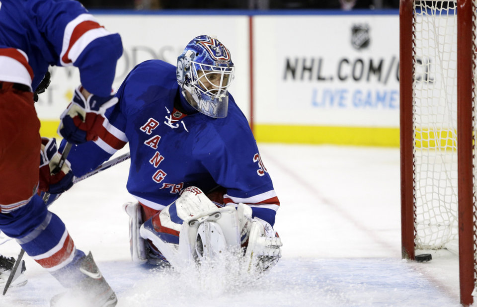 Photo - New York Rangers goalie Henrik Lundqvist (30), of Sweden, watches a puck shot by Philadelphia Flyers' Wayne Simmonds (17) get past him for a goal during the first period of an NHL hockey game Tuesday, March 5, 2013, in New York. (AP Photo/Frank Franklin II)
