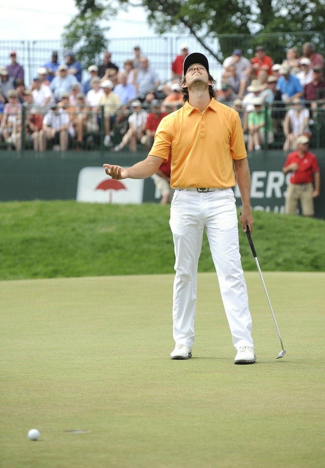 Photo - Aaron Baddeley, of Australia, reacts after missing a birdie putt on the ninth hole during the final round of the Travelers Championship golf tournament in Cromwell, Conn., Sunday, June 22, 2014. (AP Photo/Fred Beckham)