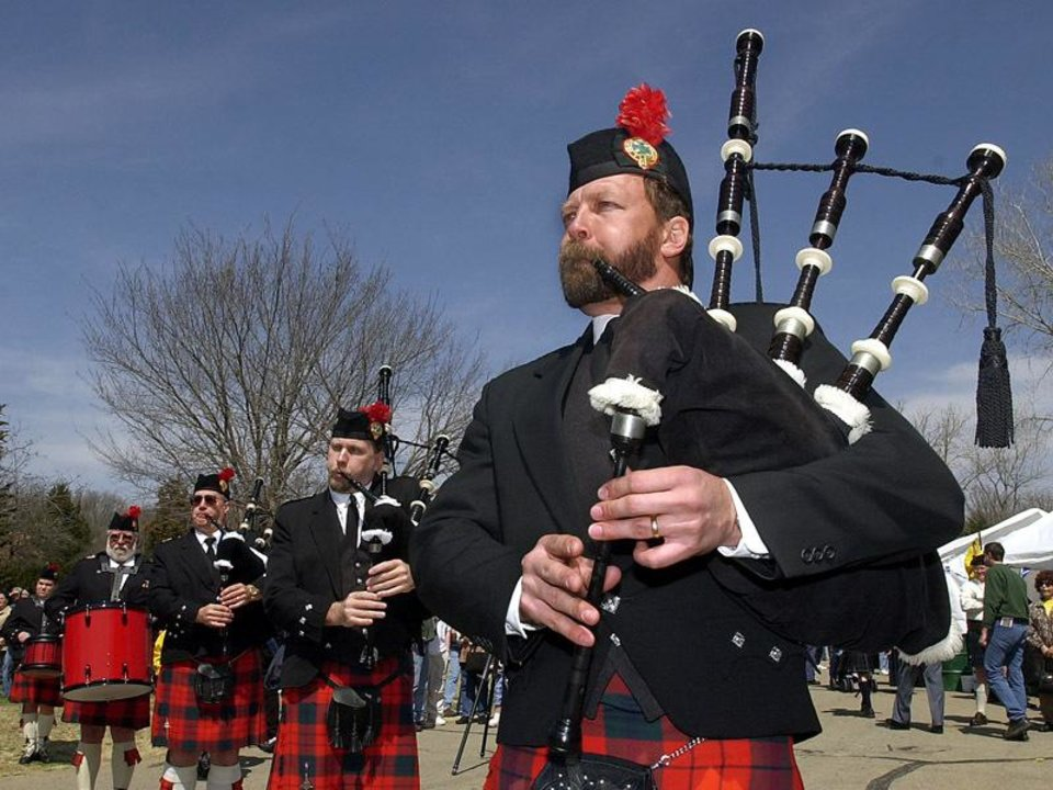 Photo - The Scottish culture is evident in Oklahoma in such events as the U.S.C.O. Scottish Heritage Festival.  Here Rick Ewing, from Tulsa, joins a group of bagpipers. Staff  Photo by David McDaniel