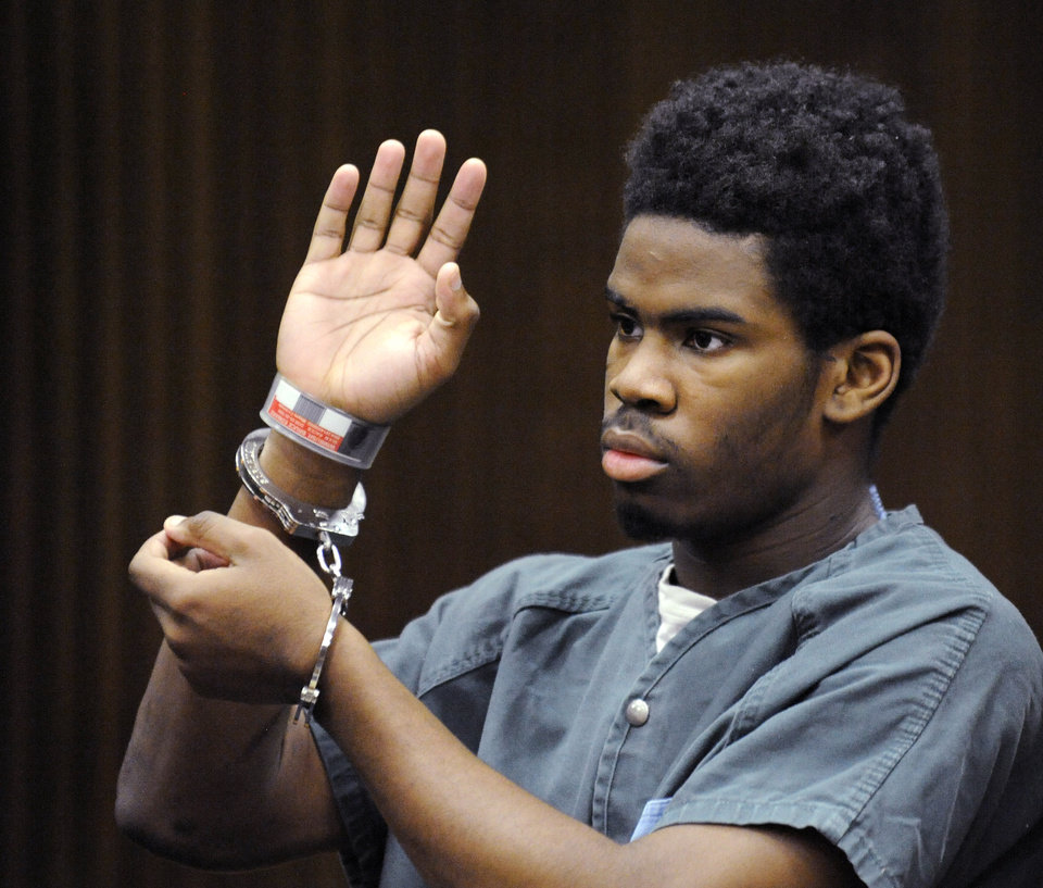 Photo - Defendant Bruce Wimbush takes a plea deal before Judge James Callahan at Frank Murphy Hall of Justice in Detroit on Monday, June 16, 2014. Wimbush has pleaded guilty in the Detroit mob beating of a motorist who accidentally struck a child with his pickup. (AP Photo/The Detroit News, David Coates)