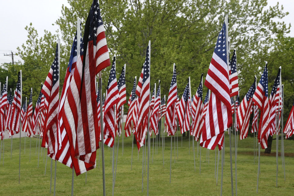 Photo -  The Field of Flags is on display at Oklahoma Christian University.  [PHOTO BY PAUL HELLSTERN, THE OKLAHOMAN ARCHIVES]
