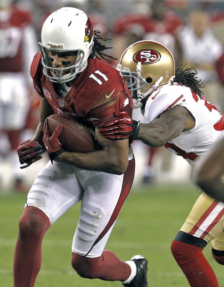 Arizona Cardinals wide receiver Larry Fitzgerald (11) breaks the tackle of San Francisco 49ers free safety Dashon Goldson during the second half of an NFL football game, Monday, Oct. 29, 2012, in Glendale, Ariz. The San Francisco 49ers won 24-3. (AP Photo/Ross D. Franklin)