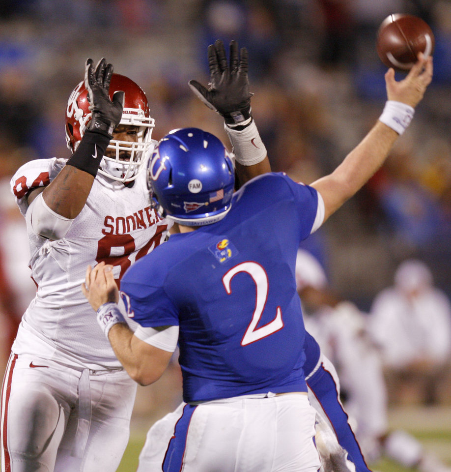 Oklahoma\'s Frank Alexander (84) pressures Kansas\' Jordan Webb (2) during the college football game between the University of Oklahoma Sooners (OU) and the University of Kansas Jayhawks (KU) at Memorial Stadium in Lawrence, Kansas, Saturday, Oct. 15, 2011. Photo by Bryan Terry, The Oklahoman