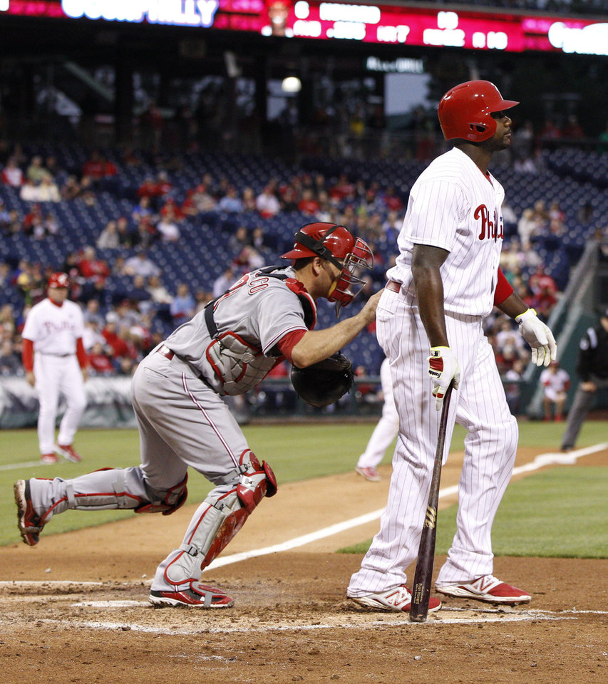 Photo - Philadelphia Phillies' Ryan Howard, right, gets tagged out by Cincinnati Reds' catcher Devin Mesoraco, left, after striking out and stranding two runners during the third inning of a baseball game, Friday, May 16, 2014, in Philadelphia. (AP Photo/Chris Szagola)